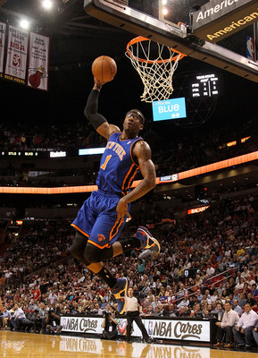 MIAMI, FL - FEBRUARY 27:  Amar'e Stoudemire #1 of the New York Knicks dunks during a game against the the Miami Heat at American Airlines Arena on February 27, 2011 in Miami, Florida. NOTE TO USER: User expressly acknowledges and agrees that, by downloadi