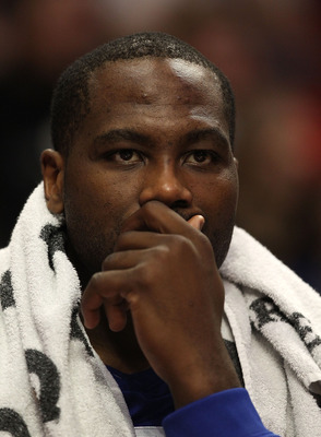 CHICAGO, IL - DECEMBER 21: Elton Brand #42 of the Philadelphia 76ers watches from the bench as his teammates take on the Chicago Bulls at the United Center on December 21, 2010 in Chicago, Illinois. The Bulls defeated the 76ers 121-76. NOTE TO USER: User