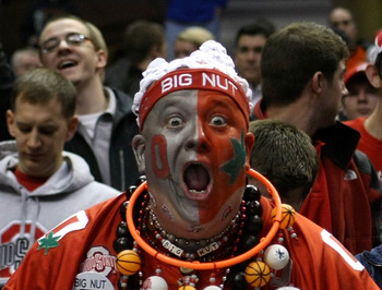INDIANAPOLIS, IN - MARCH 13:  John 'Big Nut' Peters, fan of the Ohio State Buckeyes holds up a sign which reads '2010-11 Big Ten Champs' after they won 71-60 against the Penn State Nittany Lions during the championship game of the 2011 Big Ten Men's Baske