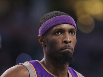 BOSTON, MA - MARCH 02:  Hakim Warrick #21 of the Phoenix Suns looks on during the game against the Boston Celtics on March 2, 2011 at the TD Garden in Boston, Massachusetts.  The Celtics defeated the Suns 115-103. NOTE TO USER: User expressly acknowledges