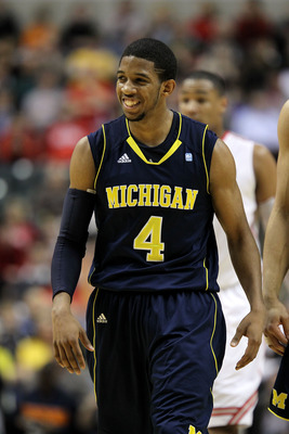 INDIANAPOLIS, IN - MARCH 12:  Darius Morris #4 of the Michigan Wolverines smiles as he looks on against the Ohio State Buckeyes during the semifinals of the 2011 Big Ten Men's Basketball Tournament at Conseco Fieldhouse on March 12, 2011 in Indianapolis,