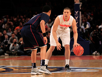 NEW YORK, NY - MARCH 11:  Brandon Triche #20 of the Syracuse Orange brings the ball up court against Shabazz Napier #13 of the Connecticut Huskies during the semifinals of the 2011 Big East Men's Basketball Tournament presented by American Eagle Outfitter