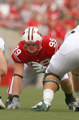 MADISON, WI - SEPTEMBER 26: J.J. Watt #99 of the Wisconsin Badgers gets ready on the line against the Michigan State Spartans on September 26, 2009 at Camp Randall Stadium in Madison, Wisconsin. (Photo by Jonathan Daniel/Getty Images)