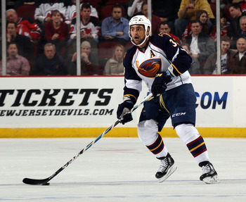 NEWARK, NJ - MARCH 15:  Dustin Byfuglien #33 of the Atlanta Thrashers skates against the New Jersey Devils at the Prudential Center on March 15, 2011 in Newark, New Jersey. The Devils defeated the Thrashers 4-2.  (Photo by Bruce Bennett/Getty Images)