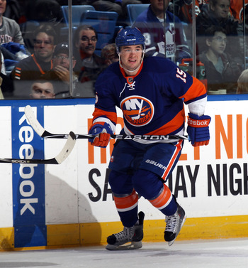 UNIONDALE, NY - MARCH 08:  P.A. Parenteau #15 of the New York Islanders skates against the Toronto Maple Leafs at the Nassau Coliseum on March 8, 2011 in Uniondale, New York. The Islanders defeated the Leafs 4-3 in overtime.  (Photo by Bruce Bennett/Getty