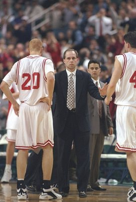 6 Mar 1997:  Coach Herb Sendek of the North Carolina State Wolfpack speaks with two of his players during a playoff game against the Georgia Tech Yellow Jackets at the Greensboro Coliseum in Greensboro, North Carolina.  North Carolina State won the game 6