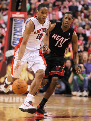 TORONTO, CANADA - FEBRUARY 16:  DeMar DeRozan #10 of the Toronto Raptors drives back up court while being covered by Mario Chalmers #15 of the Miami Heat in a game on February 16, 2011 at the Air Canada Centre in Toronto, Canada. The Heat defeated the Rap