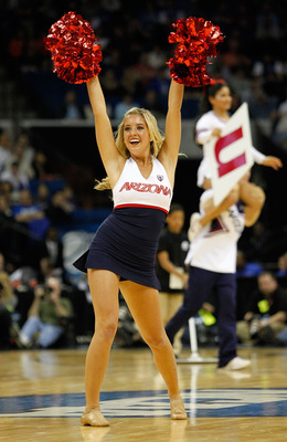 TULSA, OK - MARCH 18:  An Arizona Wildcats cheerleader performs during the second round game against the Memphis Tigers in the 2011 NCAA men's basketball tournament at BOK Center on March 18, 2011 in Tulsa, Oklahoma.  (Photo by Tom Pennington/Getty Images