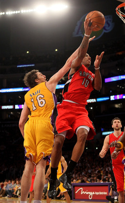 LOS ANGELES, CA - NOVEMBER 05:  DeMar DeRozan #10 of the Toronto Raptors goes up for a shot over Pau Gasol #16  of the Los Angeles Lakers at Staples Center on November 5, 2010 in Los Angeles, California.  The Lakers won 108-102.   NOTE TO USER: User expre