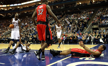 LONDON, ENGLAND - MARCH 04:  #10 DeMar DeRozan of the Raptorsis helped to his feet by team mate #32 Ed Davis during the NBA match between New Jersey Nets and the Toronto Raptors at the O2 Arena on March 4, 2011 in London, England. NOTE TO USER: User expre