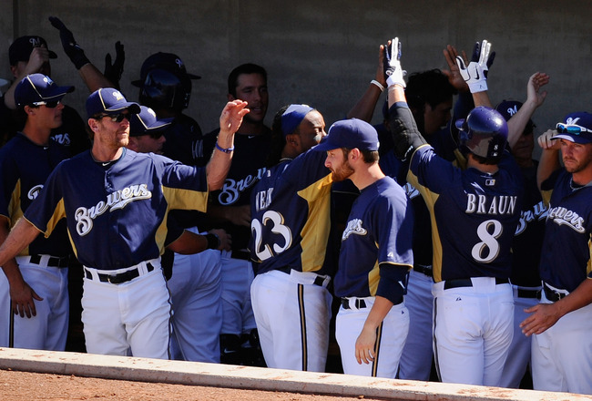 PHOENIX, AZ - MARCH 10:  Ryan Braun #8 of the Milwaukee Brewers is congratulated by teammates after hitting a three-run home run against the Colorado Rockies in the third inning of the spring training baseball game at Maryvale Baseball Park on March 10, 2