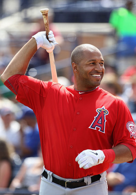 PEORIA, AZ - MARCH 15:  Vernon Wells #10 of the Los Angeles Angels of Anaheim warms up on deck during the spring training game against the San Diego Padres at Peoria Stadium on March 15, 2011 in Peoria, Arizona.  (Photo by Christian Petersen/Getty Images)