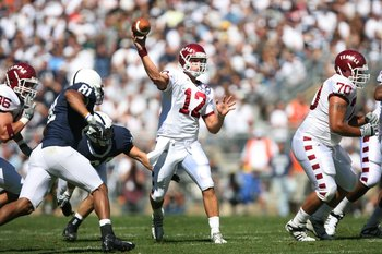 STATE COLLEGE, PA - SEPTEMBER 19: Quarterback Vaughn Charlton #12 of the Temple Owls throws a pass during a game against the Penn State Nittany Lions on September 19, 2009 at Beaver Stadium in State College, Pennsylvania. (Photo by Hunter Martin/Getty Ima