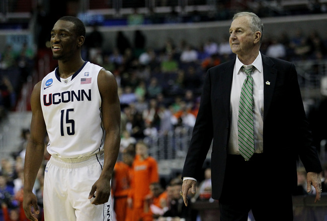 WASHINGTON - MARCH 17:  Head coach Jim Calhoun of the Connecticut Huskies and Kemba Walker #15 smile during their game against the Bucknell Bison during the second round of the 2011 NCAA men's basketball tournament at the Verizon Center on March 17, 2011