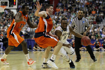WASHINGTON - MARCH 17:  Kemba Walker #15 of the Connecticut Huskies drives past Bryan Cohen #22 of the Bucknell Bison during the second round of the 2011 NCAA men's basketball tournament at the Verizon Center on March 17, 2011 in Washington, DC.  (Photo b
