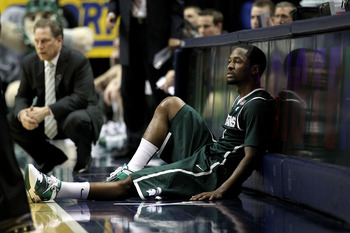 INDIANAPOLIS, IN - MARCH 12:  Kalin Lucas #1 of the Michigan State Spartans sits next to the scorer's table against the Penn State Nittany Lions during the semifinals of the 2011 Big Ten Men's Basketball Tournament at Conseco Fieldhouse on March 12, 2011