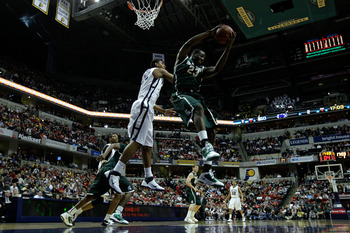 INDIANAPOLIS, IN - MARCH 12: Draymond Green #23 of the Michigan State Spartans controls a rebound against the Penn State Nittany Lions during the semifinals of the 2011 Big Ten Men's Basketball Tournament at Conseco Fieldhouse on March 12, 2011 in Indiana