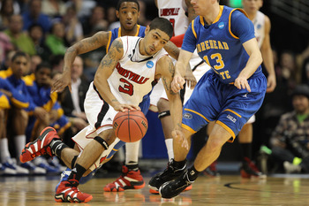DENVER, CO - MARCH 17:  Peyton Siva #3 of the Louisville Cardinals handles the ball against Ty Proffitt #13 of the Morehead State Eagles and Lamont Austin #10 during the second round of the 2011 NCAA men's basketball tournament at Pepsi Center on March 17