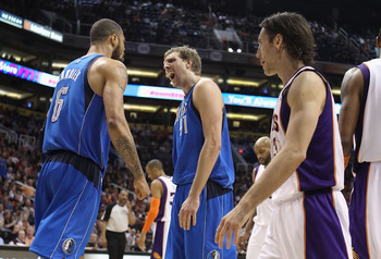 PHOENIX, AZ - FEBRUARY 17:  Dirk Nowitzki #41 of the Dallas Mavericks reacts to teammate Tyson Chandler #6 after Chandler scored and drew a foul against the Phoenix Suns during the NBA game at US Airways Center on February 17, 2011 in Phoenix, Arizona.  T