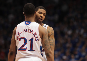 LAWRENCE, KS - FEBRUARY 12:  Marcus Morris #22 of the Kansas Jayhawks hugs his brother Markieff Morris #21 during the game against the Iowa State Cyclones on February 12, 2011 at Allen Fieldhouse in Lawrence, Kansas.  (Photo by Jamie Squire/Getty Images)