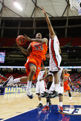 ATLANTA, GA - MARCH 10:  Earnest Ross #33 of the Auburn Tigers shoots against Trey Thompkins #33 of the Georgia Bulldogs during the the first round of the SEC Men's Basketball Tournament at the Georgia Dome on March 10, 2011 in Atlanta, Georgia.  (Photo b