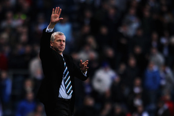 BLACKBURN, ENGLAND - FEBRUARY 12:  Newcastle Manager Alan Pardew acknowledges the fans after the Barclays Premier League match between Blackburn Rovers and Newcastle United at Ewood Park on February 12, 2011 in Blackburn, England.  (Photo by Dean Mouhtaro