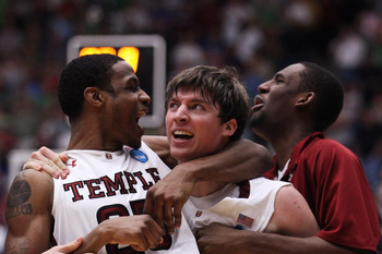 TUCSON, AZ - MARCH 17:  Juan Fernandez #4 celebrates with Lavoy Allen #24 of the Temple Owls after scoring the winning basket to defeat the Penn State Nittany Lions 66 to 64 in the second round of the 2011 NCAA men's basketball tournament at McKale Center