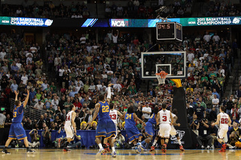 DENVER, CO - MARCH 17:  Demonte Harper #22 of the Morehead State Eagles shoots the game winning three point shot with 5.5 seconds left on the clock against the Louisville Cardinals during the second round of the 2011 NCAA men's basketball tournament at Pe