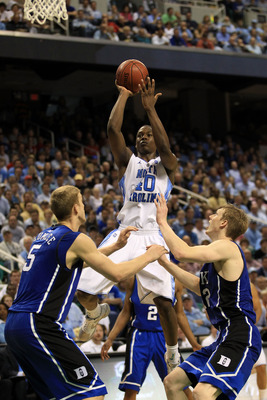 GREENSBORO, NC - MARCH 13:  Harrison Barnes #40 of the North Carolina Tar Heels shoots against Mason Plumlee #5 and Kyle Singler #12 of the Duke Blue Devils during the second half in the championship game of the 2011 ACC men's basketball tournament at the