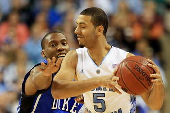 GREENSBORO, NC - MARCH 13:  Kendall Marshall #5 of the North Carolina Tar Heels protects the ball against Nolan Smith #2 of the Duke Blue Devils during the first half in the championship game of the 2011 ACC men's basketball tournament at the Greensboro C