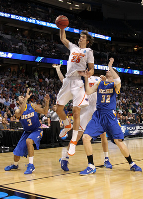 TAMPA, FL - MARCH 17:  Chandler Parsons #25 of the Florida Gators  controls a rebound against Jon Pastorek #32 and Jordan Weiner #3 of the UC Santa Barbara Gauchos in the first half during the second round of the 2011 NCAA men's basketball tournament at S