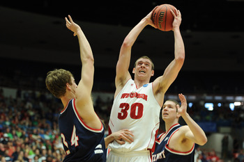TUCSON, AZ - MARCH 17:  Jon Leuer #30 of the Wisconsin Badgers goes up against Mick Hedgepeth #34 and Trevor Noack #30 of the Belmont Bruins during the second round of the 2011 NCAA men's basketball tournament at McKale Center on March 17, 2011 in Tucson,