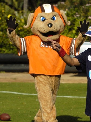 A young punter lines up a kick as the Cleveland Browns mascot watches during the Special Olympics  February 8, 2006 in Honolulu, Hawaii.  (Photo by Al Messerschmidt/Getty Images)