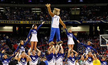 ATLANTA, GA - MARCH 11:  The Wildcat, mascot for the Kentucky Wildcats, performs with cheerleaders during their game against the Ole Miss Rebels in the quarterfinals of the SEC Men's Basketball Tournament at Georgia Dome on March 11, 2011 in Atlanta, Geor