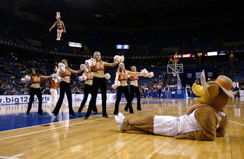 KANSAS CITY, MO - MARCH 10:  Hook'Em the Texas Longhorns mascot watches the cheerleaders and dance team perform in the second half against the Colorado Buffaloes in Day 1 of the Phillips 66 Big 12 Men?s Basketball Tournament on March 10, 2005 at Kemper Ar