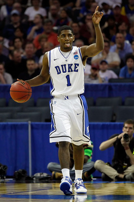 CHARLOTTE, NC - MARCH 18:  Kyrie Irving #1 of the Duke Blue Devils calls a play in the first half while taking on the Hampton Pirates during the second round of the 2011 NCAA men's basketball tournament at Time Warner Cable Arena on March 18, 2011 in Char