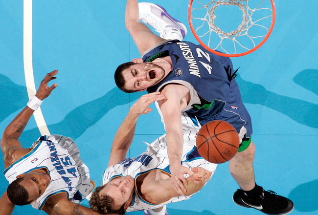 NEW ORLEANS - FEBRUARY 08: Kevin Love #42 of the Minnesota Timberwolves fights for a rebound with Sean Marks #4 of the New Orleans Hornets on February 8, 2009 in New Orleans, Louisiana.  The Hornets defeated the Timberwolves 101-97.  NOTE TO USER: User ex