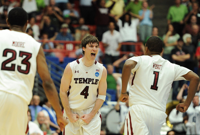 TUCSON, AZ - MARCH 17:  Juan Fernandez #4 celebrates with teammates Khalif Wyatt #1 and Ramone Moore #23 of the Temple Owls after he scored the winning basket to defeat the Penn State Nittany Lions 66 to 64 in the second round of the 2011 NCAA men's baske
