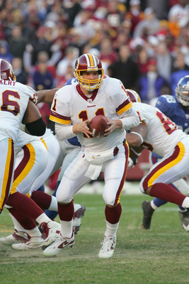 LANDOVER, MD - DECEMBER 24:  Quarterback Patrick Ramsey #11 of the Washington Redskins looks to hand off against the New York Giants at FedExField on December 24, 2005 in Landover, Maryland. The Redskins defeated the Giants 35-10. (Photo by Jim McIsaac/Ge