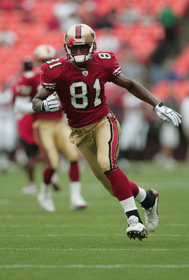 SAN FRANCISCO - SEPTEMBER 12:  Wide receiver Rashaun Woods #81 of the San Francisco 49ers carries the ball against the Atlanta Falcons during the game at 3Com Park on September 12, 2004 in San Francisco, California. The Falcons won 21-19.  (Photo by Jed J
