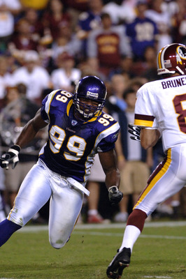 Minnesota Vikings  defensive end Erasmus James rushes the pocket  against the Washington Redskins on ESPN Monday Night Football September 11, 2006 in Washington.  The Vikings won 19 - 16.  (Photo by Al Messerschmidt/Getty Images)