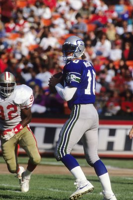 SAN FRANCISCO, CA - AUGUST 28:  Quarterback Dan McGwire #10 of the Seattle Seahawks looks down field for a receiver during the exhibition game against the San Francisco 49ers at Candlestick Park on August 28, 1992 in San Francisco, California.  The 49ers