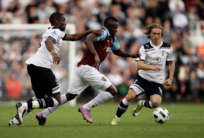 LONDON, ENGLAND - SEPTEMBER 25:  Victor Obinna of West Ham  is challenged by Sebastien Bassong  (L) and Luka Modric of Spurs during the Barclays Premier League match between West Ham United and Tottenham Hotspur at the Boleyn Ground on September 25, 2010