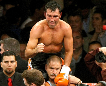 CARSON, CA - MAY 3:  Oscar De La Hoya celebrates after getting the decision over Steve Forbes during their junior middleweight bout at the Home Depot Center on May 3, 2008 in Carson, California.  (Photo by Stephen Dunn/Getty Images)