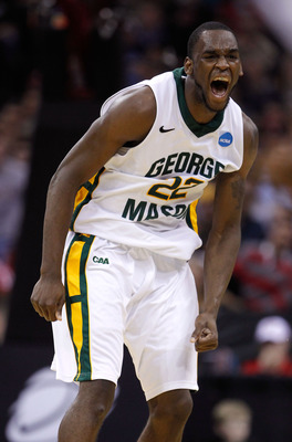 CLEVELAND, OH - MARCH 18:  Mike Morrison #22 of the George Mason Patriots celebrates after a dunk late in the game against the Villanova Wildcats during the second round of the 2011 NCAA men's basketball tournament at Quicken Loans Arena on March 18, 2011