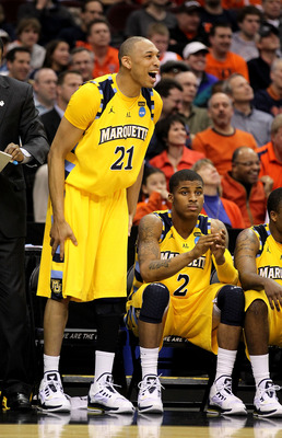 CLEVELAND, OH - MARCH 18: Joseph Fulce #21 and Vander Blue #2 of the Marquette Golden Eagles look on from the bench late in the second half against the Xavier Musketeers during the second round of the 2011 NCAA men's basketball tournament at Quicken Loans