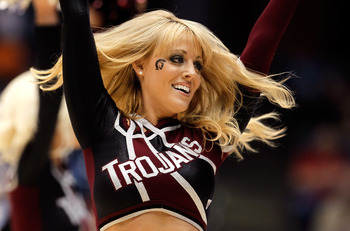 DAYTON, OH - MARCH 15:  An Arkansas Little Rock Trojans cheerleader performs on the court during the game against the North Carolina-Asheville Bulldogs during the first round of the 2011 NCAA men's basketball tournament at UD Arena on March 15, 2011 in Da