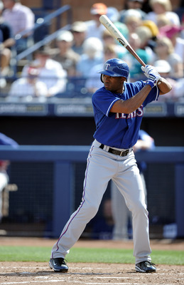 PEORIA, AZ - MARCH 01:  Endy Chavez #9 of the Texas Rangers at bat against the Seattle Mariners during spring training at Peoria Stadium on March 1, 2011 in Peoria, Arizona.  (Photo by Harry How/Getty Images)