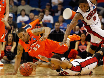 TULSA, OK - MARCH 18:  Anthony Marshall #3 of the UNLV Rebels and Demetri McCamey #32 of the Illinois Fighting Illini dive for a loose ball during the second round of the 2011 NCAA men's basketball tournament at BOK Center on March 18, 2011 in Tulsa, Okla