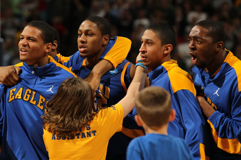 DENVER, CO - MARCH 17:  The Morehead State Eagles celebrate after defeating the Louisville Cardinals during the second round of the 2011 NCAA men's basketball tournament at Pepsi Center on March 17, 2011 in Denver, Colorado. The Morehead State Eagles defe